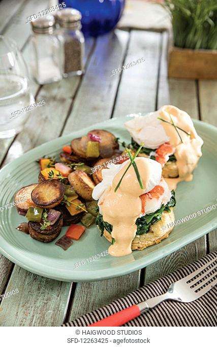 Lobster Benedict with poached eggs, spinach, buttermilk biscuits and creole hollandaise