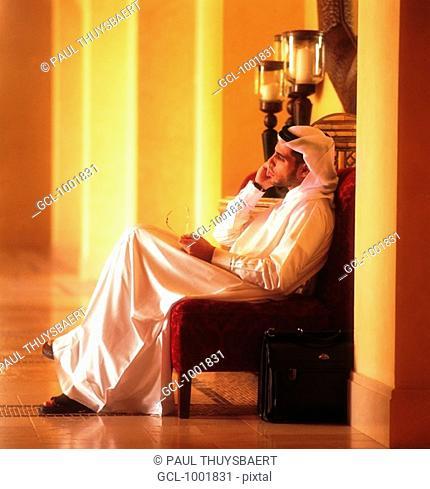 Arab man using a cell phone