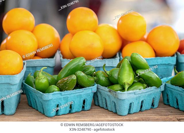 Cartons full of jalapenos peppers and yellow peppers for sale at farmers' market, Rehoboth Beach, Delaware