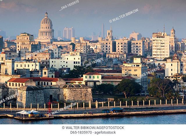 Cuba, Havana, Havana Vieja, elevated view of buildings along Havana Bay, dawn