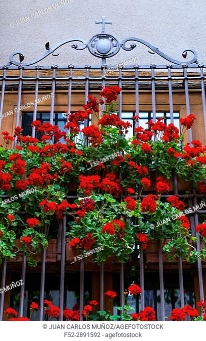 Window decorated with flowers. Toledo city, Toledo, Castilla-La Mancha, Spain