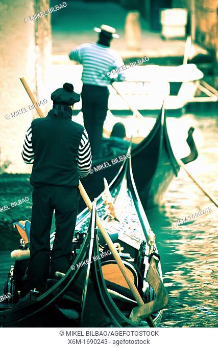 Gondolier and gondola  Venice, Italy
