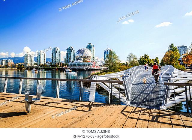 View of False Creek and city skyline, World of Science Dome, people walking, Vancouver, British Columbia, Canada, North America