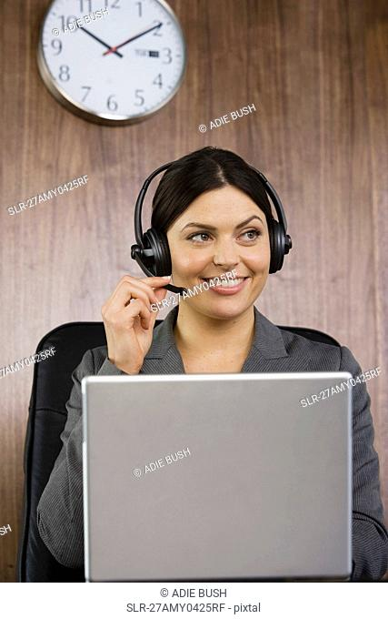 Business woman on telephone headset