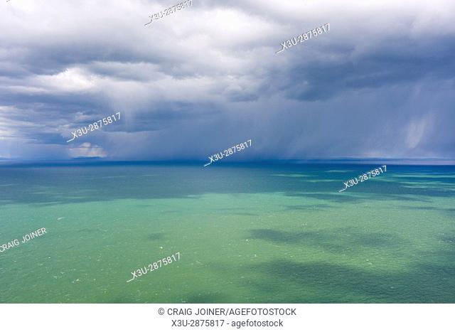 A rainstorm over the Bristol Channel viewed from the Exmoor National Park coast near Lynmouth, North Devon, England