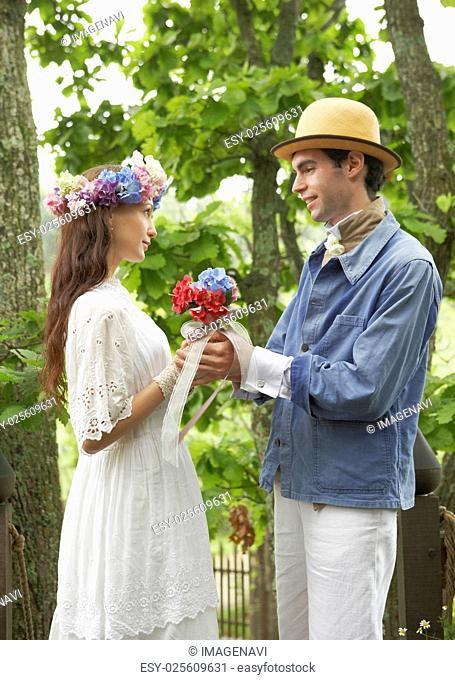 Bridal couple holding a bouquet