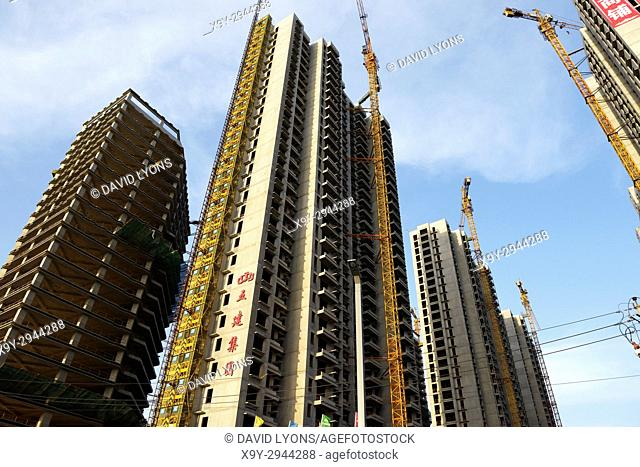 City of Taiyuan, Shanxi, China. New and under construction apartment blocks high rise accommodation, some are private sector property ventures