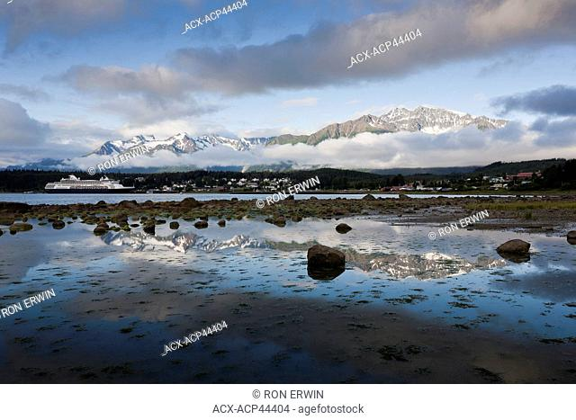 The cruise ship Veendam and the city of Haines as seen from Lutak Road, Haines, Alaska, United States of America