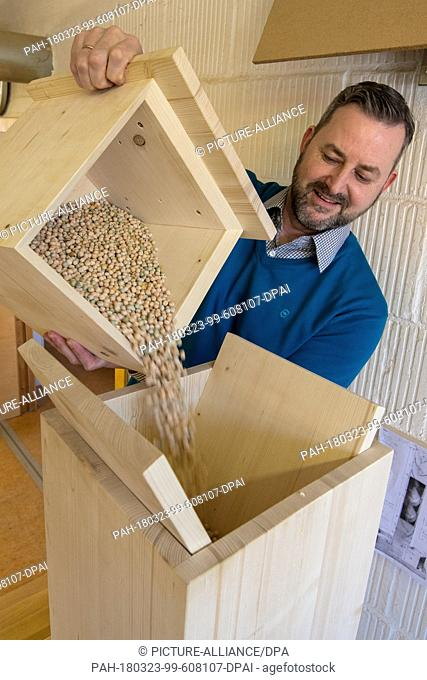 21 March 2018, Germany, Bayreuth: Ingo Berens from the Bavarian CastleAdministration in Bayreuth filling a rain machine built to baroque-era specifications...