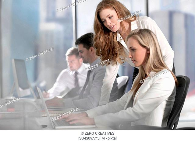 Businessmen and businesswomen working with computer and laptop in office