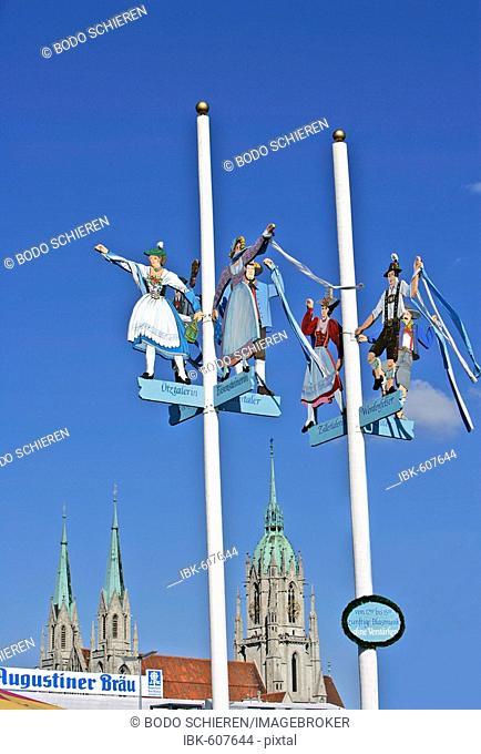 Bavarian folklore figures, national costumes, on flagpoles, Oktoberfest, Munich, Bavaria, Germany