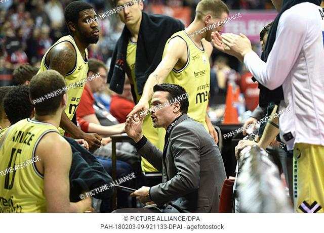 Bayreuth coach Raoul Korner speaking to his team during a time out at the German Basketball Bundesliga match between FC Bayern Munich and Medi Bayreuth at the...