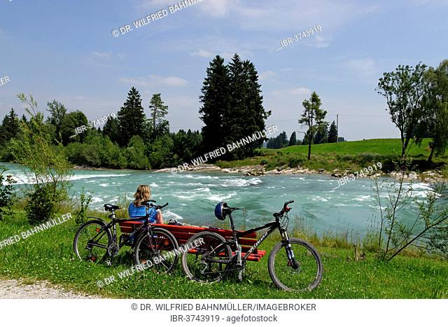 Cyclists during a break at the Lech river, Way of St James, Lechbruck am See, Swabia, Bavaria, Germany