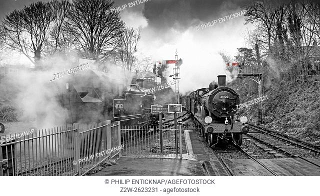 Ex LSWR Drummond T9 4-4-0 class locomotive number 30120 arriving at Alresford station with a train from Alton, whilst a LMS Ivatt 2-6-2 Tank locomotive 41312...