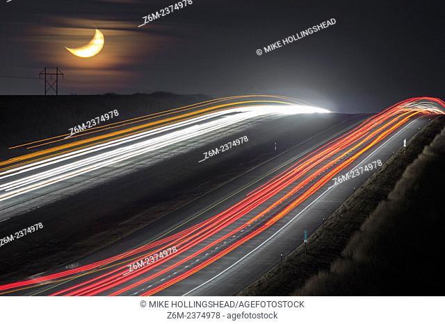 Moon sets over travellers on I80 southwest of Omaha Nebraska