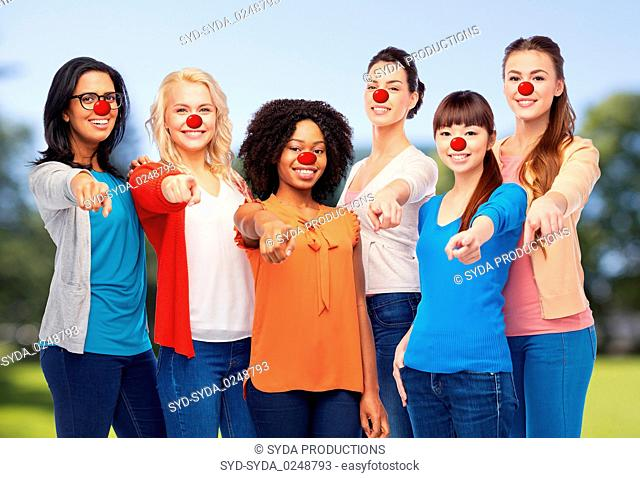 group of women pointing finger at red nose day