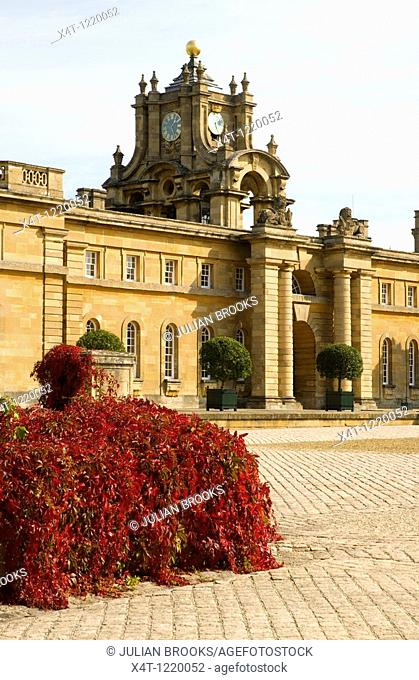 The clock tower and main entrance into Blenheim Palace courtyard  Virginia creeper turning red in foreground