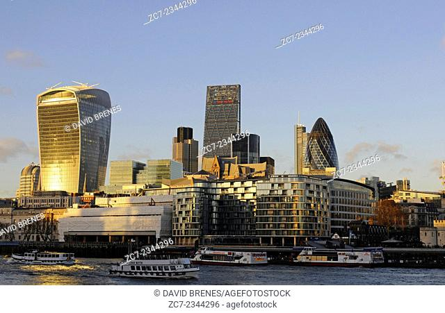 The Modern skyline of the City of London with The Walkie Talkie Building, The Gherkin, The Cheesegrater at sundown and the River Thames London England
