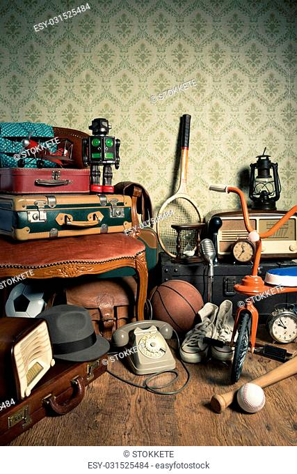 Assorted vintage items in the attic with retro wallpaper background