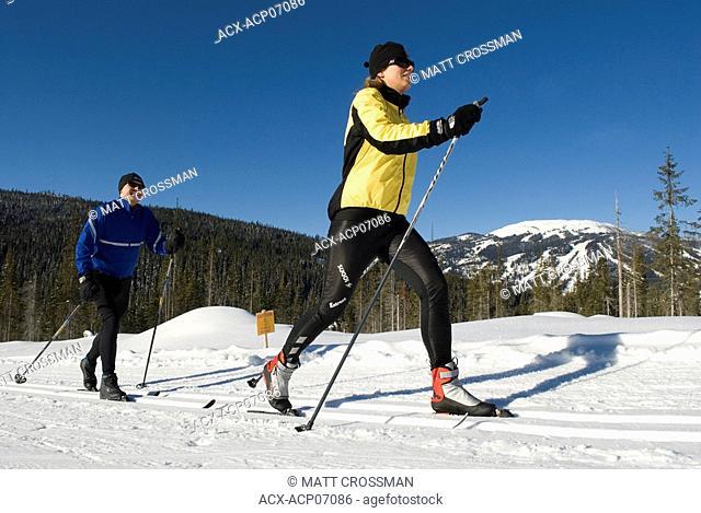 Professional couple cross country skiing, Sun Peaks Resort, British Columbia, Canada
