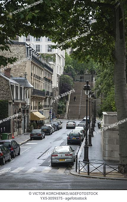 Street in Paris with stairs going uphill