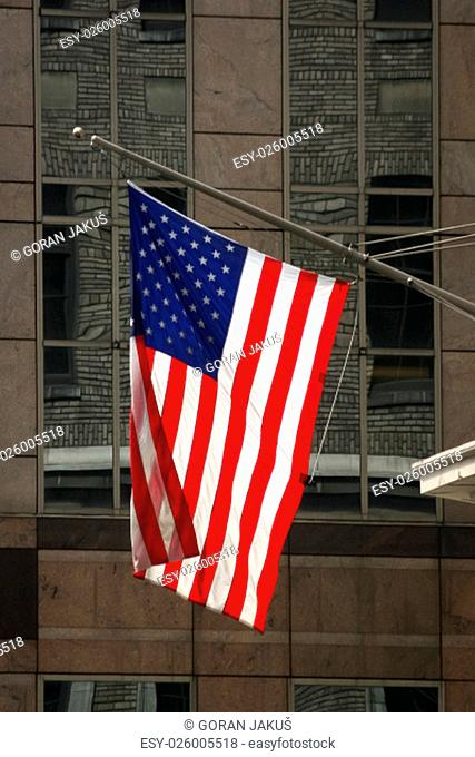 The American flag hanging on the building in Midtown Manhattan in New York City, USA