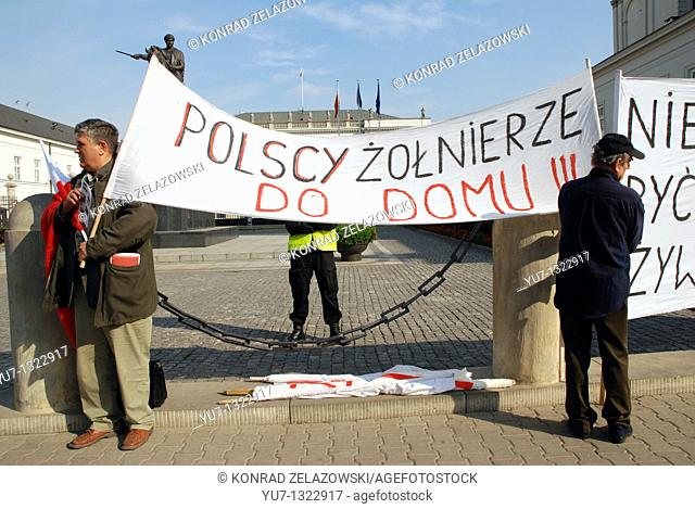Protest against the US Missile Shield in Poland, in front of presidential palace in Warsaw  Polish soldier - go back to home - said the phrase on banner