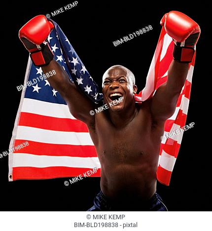 African American boxer holding American flag
