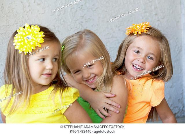 three girls being playful