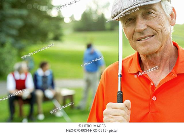 portrait of stylish senior golfer at tee-box