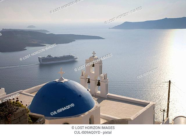 View of church and car ferry, Oia, Santorini, Cyclades, Greece