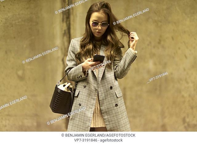 Woman using smartphone, in Munich, Germany