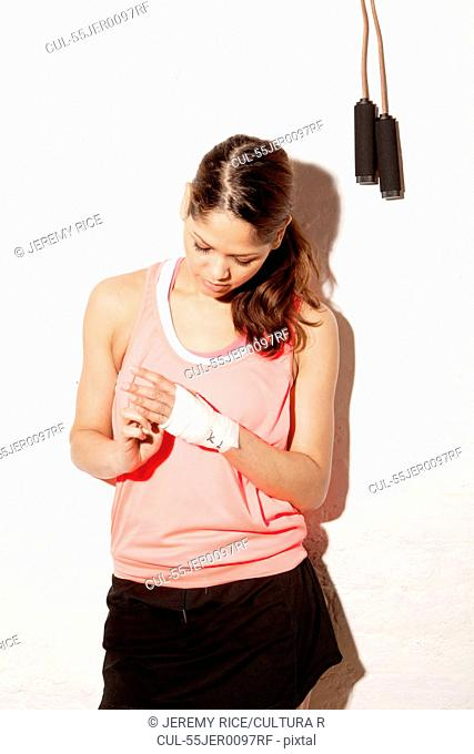 Young woman wearing bandage on wrist
