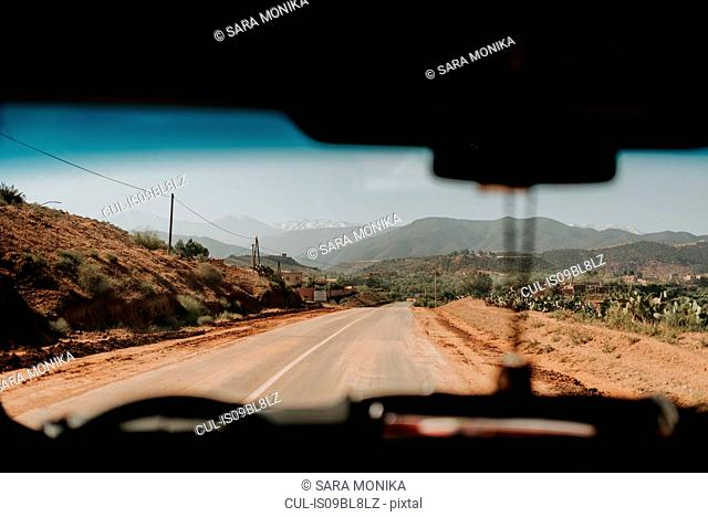 Car on the road through Atlas Mountains, Morocco