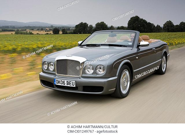 Bentley Azure, model year 2006-, anthracite, driving, diagonal from the front, frontal view, country road, open top