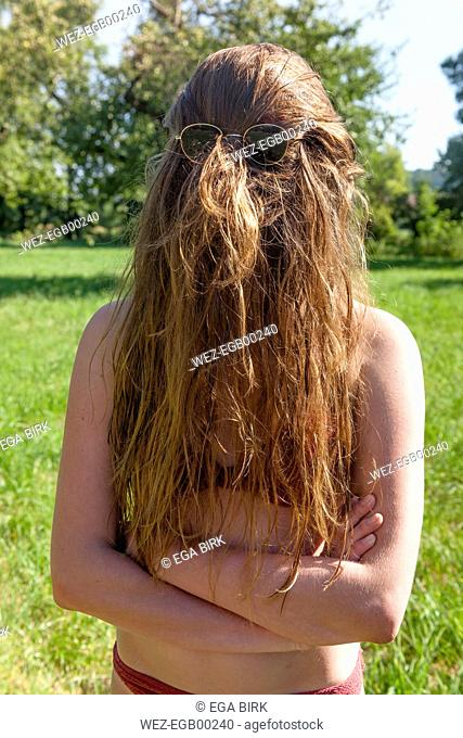 Hair covering teenager's face