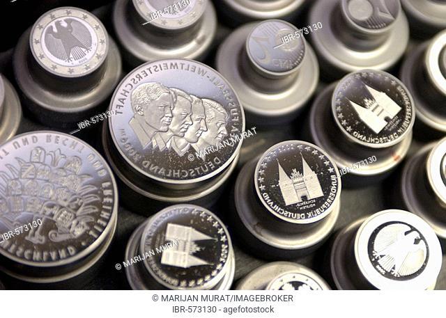 Mint stamps in coin production in the Staatlichen Muenze Bad Cannstatt, Stuttgart, Germany