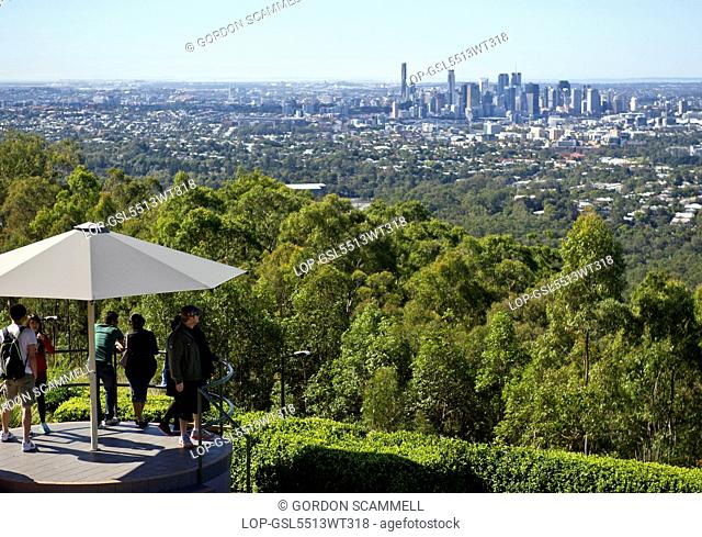 Australia, Queensland, Brisbane. Tourists looking out over the city of Brisbane from the summit of Mt Coot-Tha