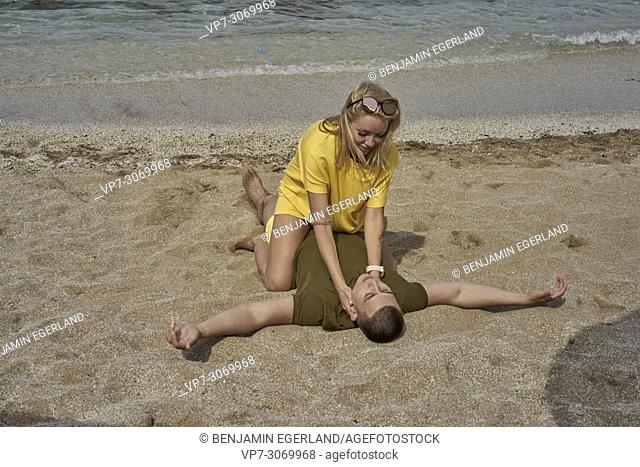 Playful young couple on the beach, Russian ethnicity, Hersonissos, Crete, Greece