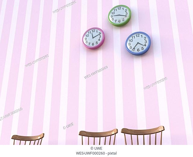 Three back rests and wall clocks in front of striped wallpaper