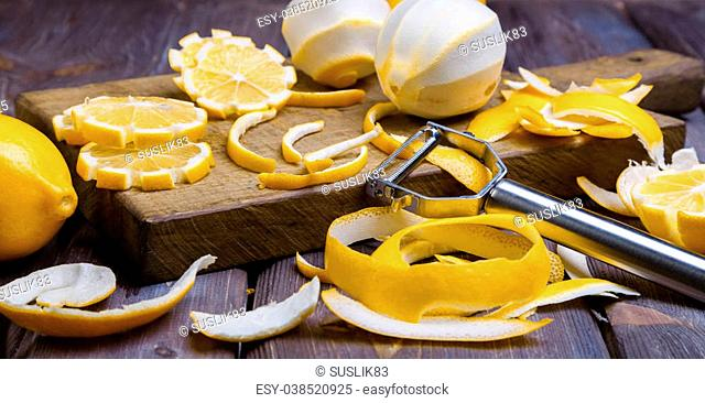 some sliced lemons on a wooden cutting board close-up in low key