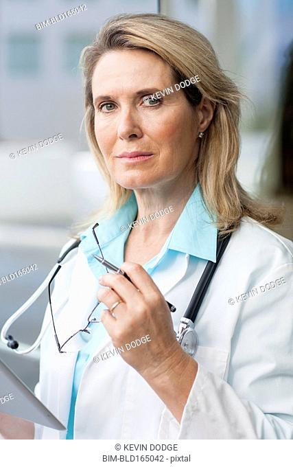 Close up of Caucasian doctor using digital tablet