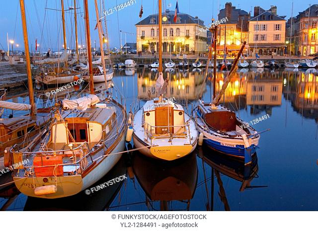 night harbour scene with lights of yaughts and harbour restaurants  Honfleur, Normandy, France
