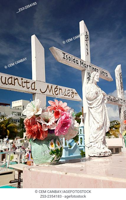 Statues and flowers on the tombstone in cemetery, Isla Mujeres, Cancun, Quintana Roo, Yucatan Province, Mexico, Central America