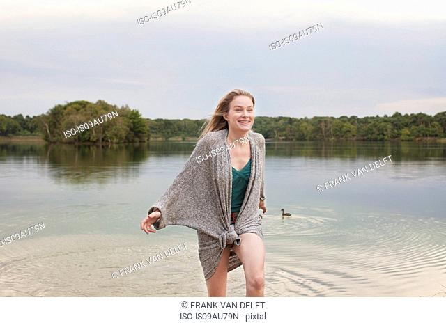 Young woman playing in lake