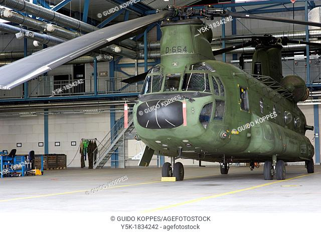 Gilze-Rijen, Netherlands. Chinhook transport helicopter standing in a hangar at Gilze-Rijen military airfield