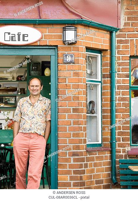 Man standing in front of a cafe