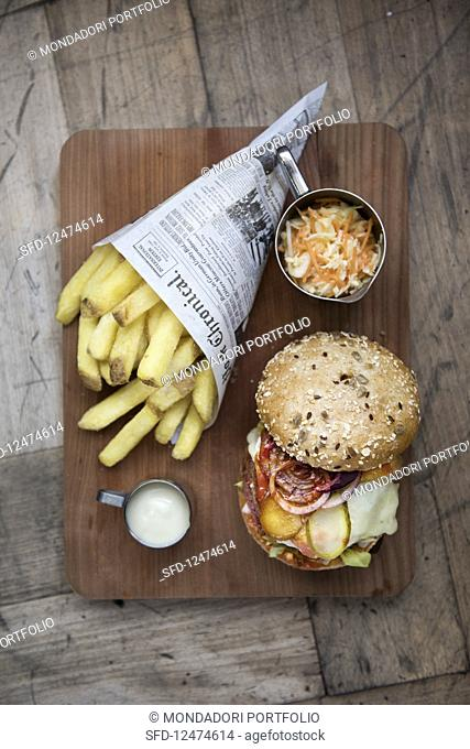 A soya burger with chips, coleslaw and mayonnaise
