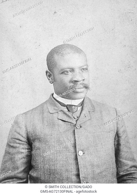 Studio portrait of an African-American man, half length, wearing a suit and tie, 1900. From the New York Public Library