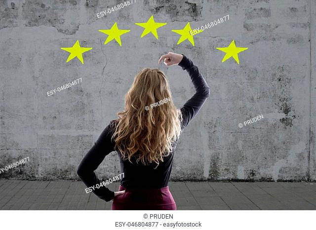 thoughtful woman with stars on background